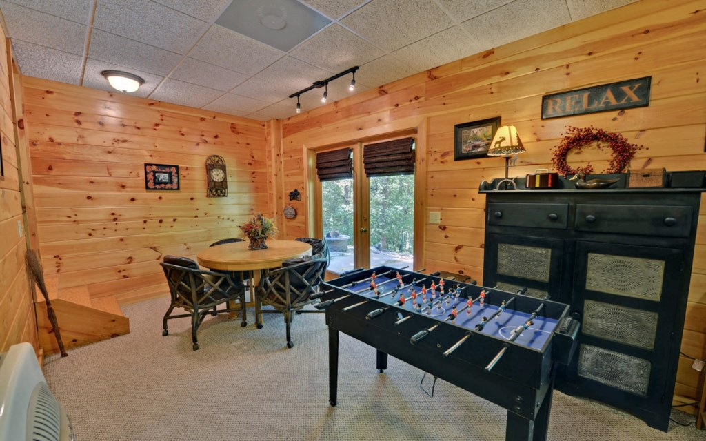 Football and Poker Table in Terrace level Game room