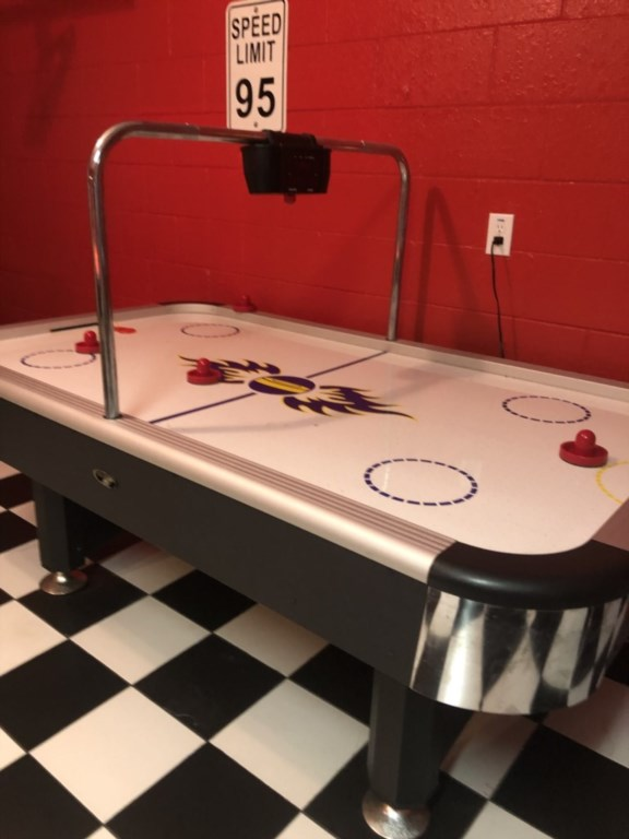 Bring out your competitive side in this fantastic Games room with Air Hockey