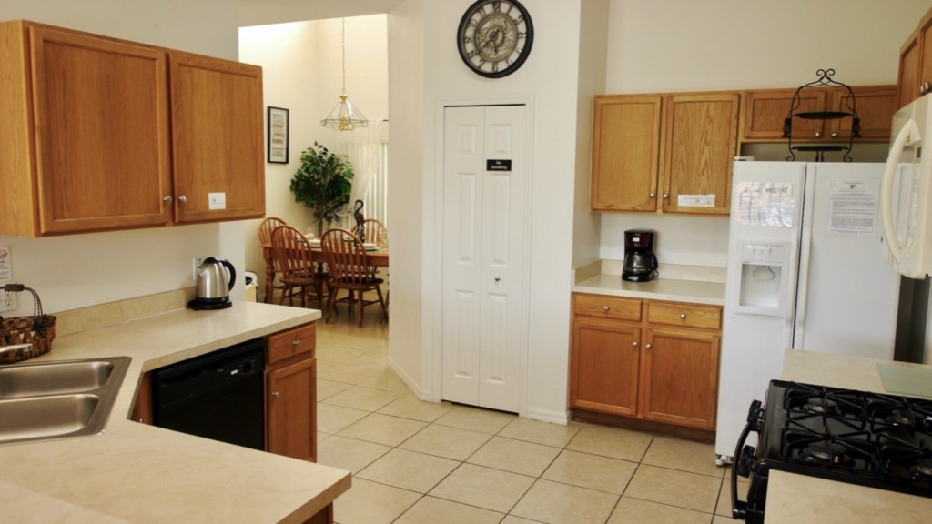 Large spacious kitchen with lots of storage and a large pantry.