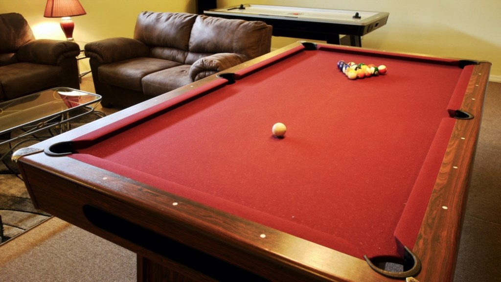 full size Professional Slate Pool Table and down-lighting.
