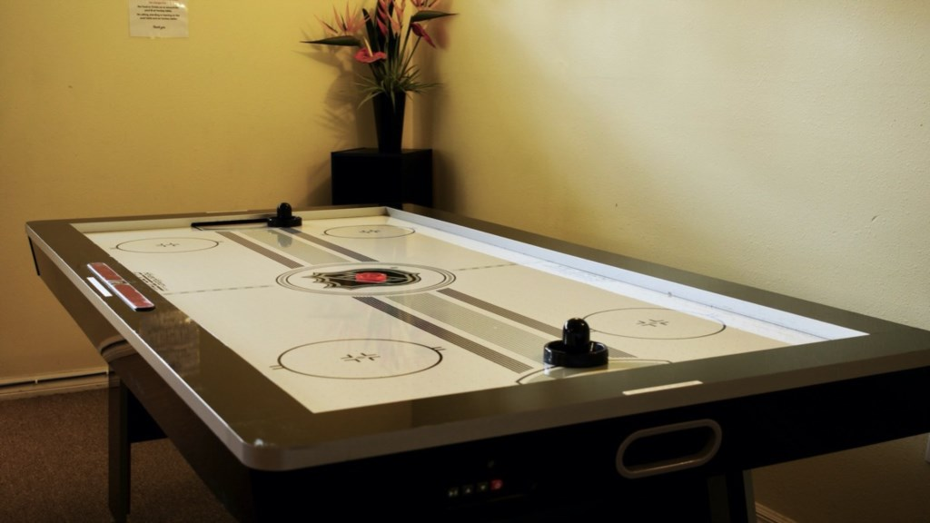Air Hockey Table with sound effects.