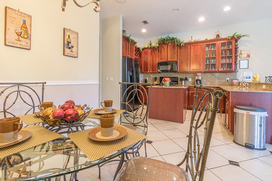 Spacious kitchen with dining room seating for 4 and bar stool seating for 3