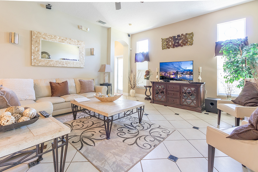 Spacious living room with flat screen televison