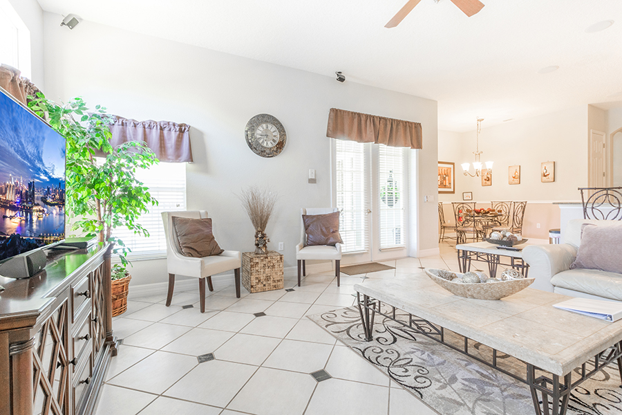 Spacious living room with easy access to the pool and lanai