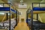 Bunk Bedroom with 5 Bunk Beds and pull out counch offering sleep for 12 people