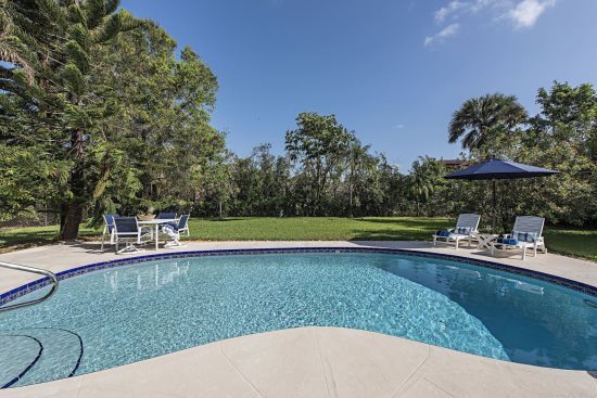 Bright, Sunny Pool and Deck Area at The Sand Dollar Beach House