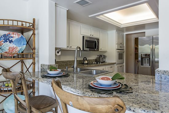 Gorgeous Granite Counters and White Kitchen at The Sand Dollar Beach House