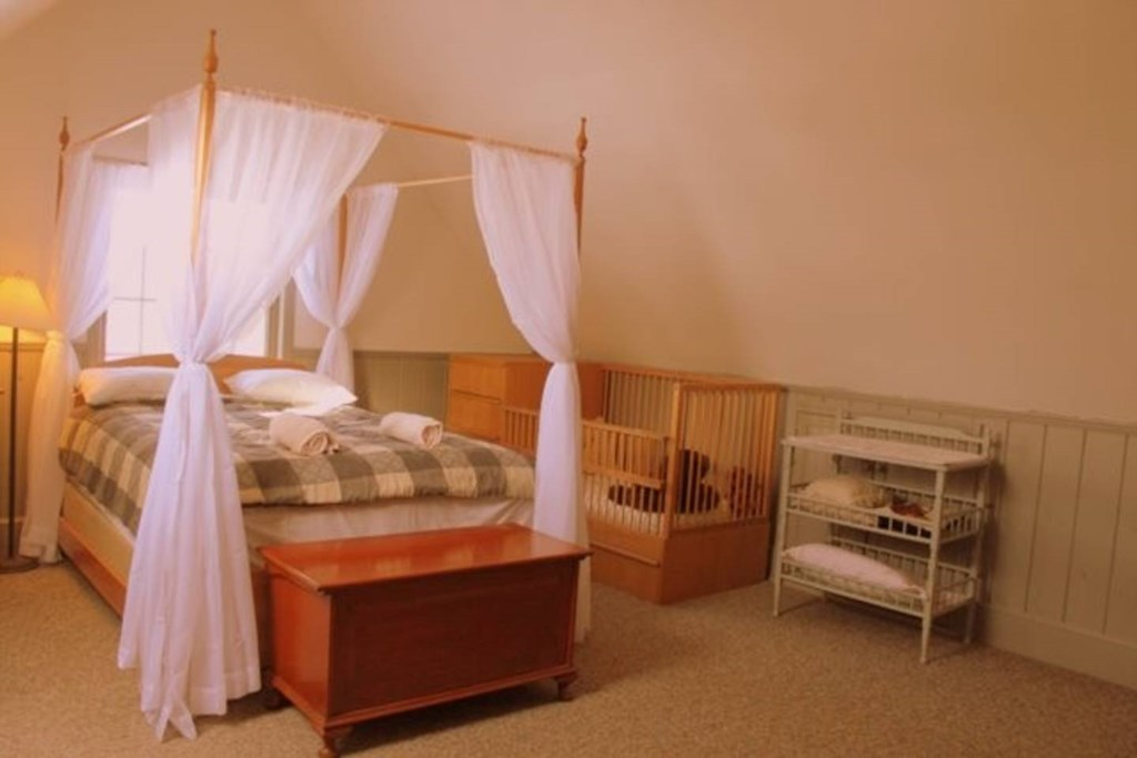 This bedroom includes a crib and changing station