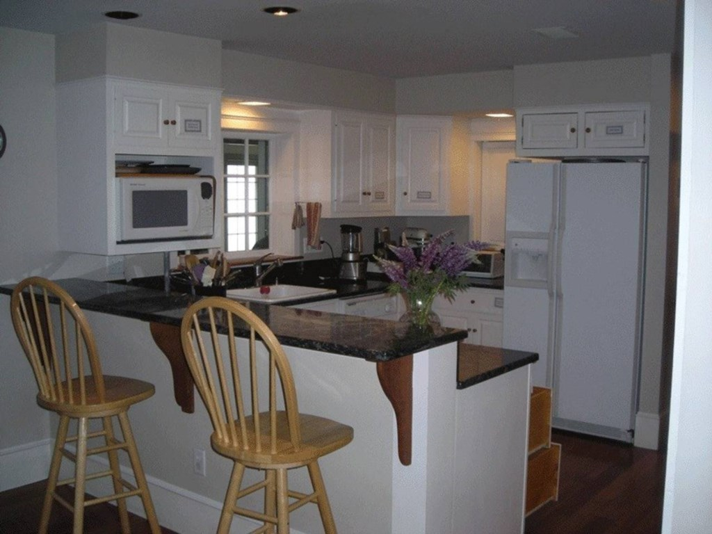 Roomy kitchen with appliances, utensils and a breakfast bar