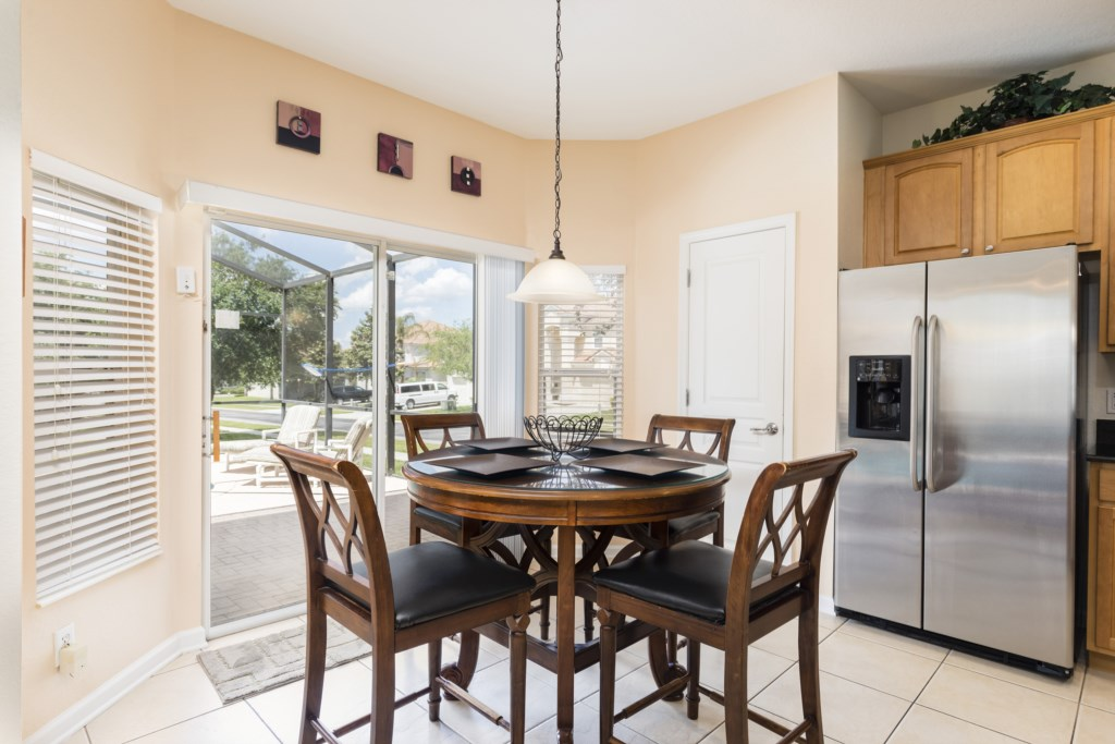 Stunning breakfast nook area with access to back patio