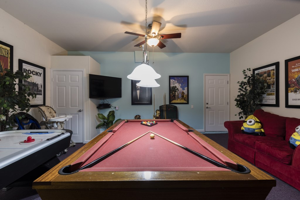 Fun game room with pool table, air hockey, and flat screen TV