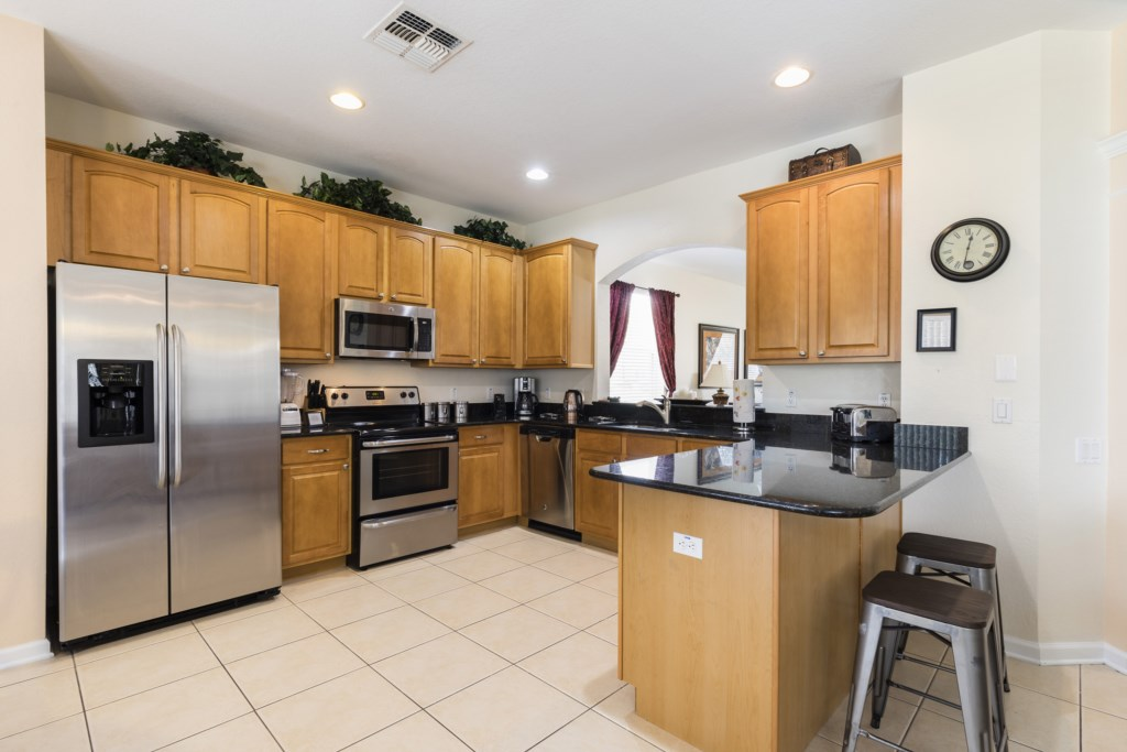 Classic kitchen with microwave, stove, oven, and double door refrigerator