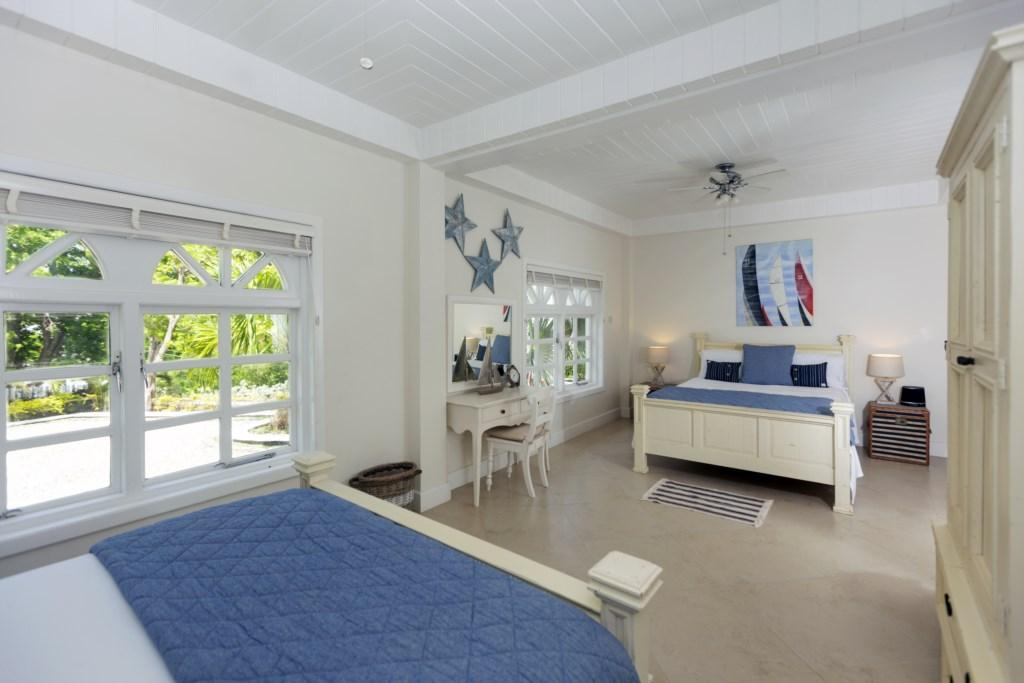 First bedroom has two queen beds.