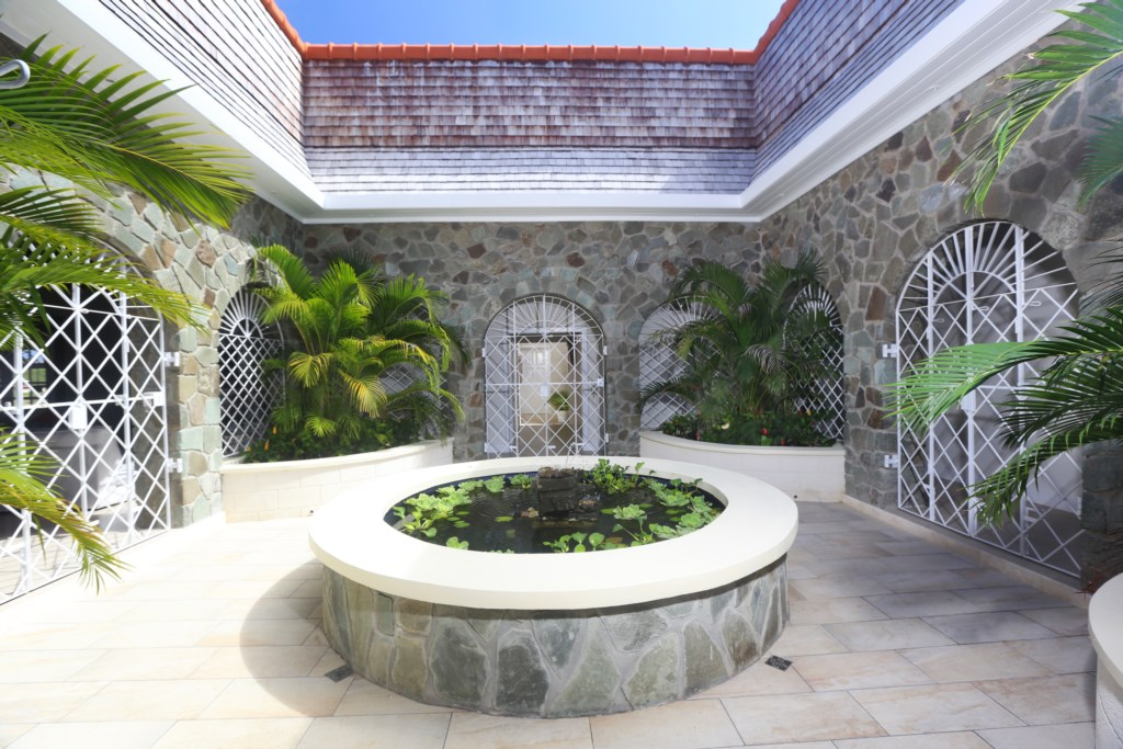Internal courtyard with koy pond adds to the atmosphere of the villa.
