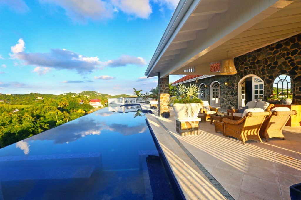Expansive outdoor space with infinity lap pool.