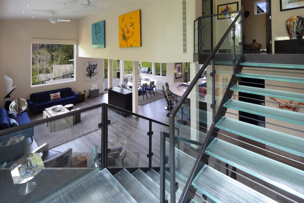 Glass Stairway down to Living Room