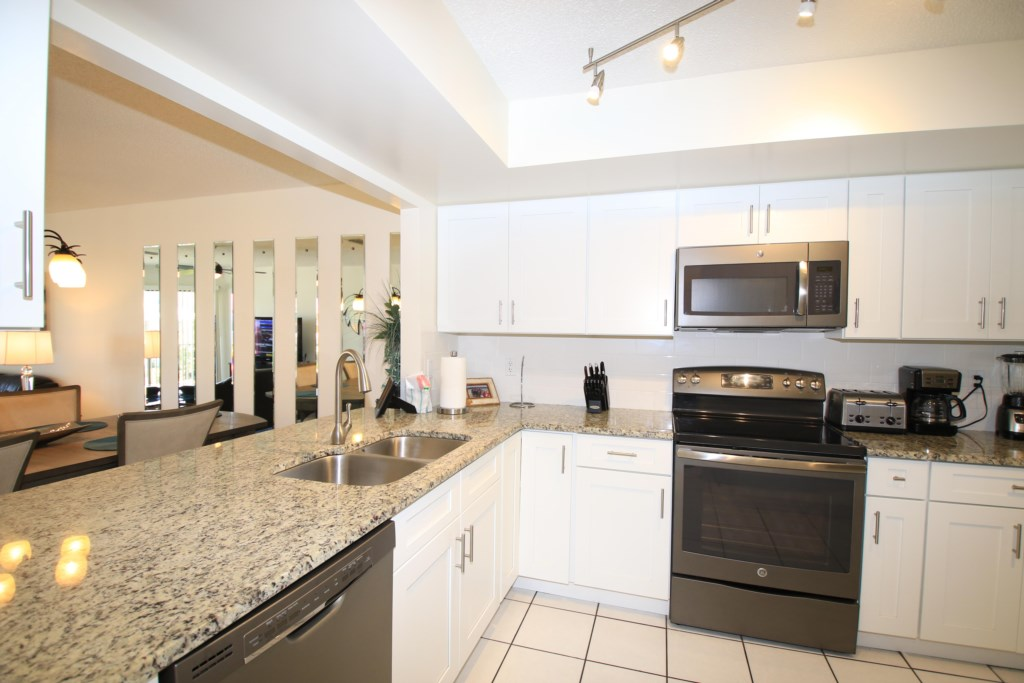 New Designer Kitchen With Exotic Granite Countertops