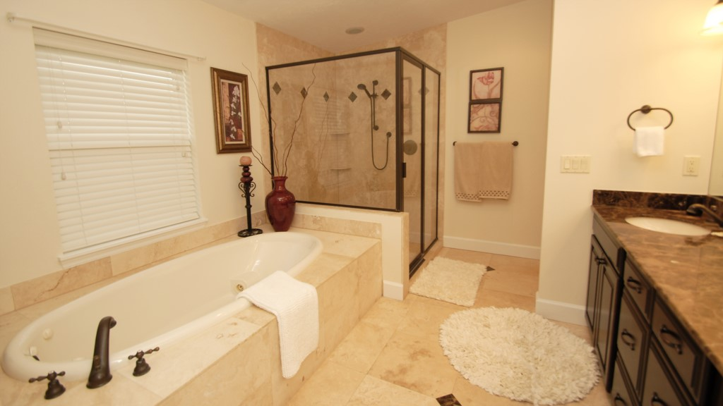 En-suite washroom with walk in shower and tub