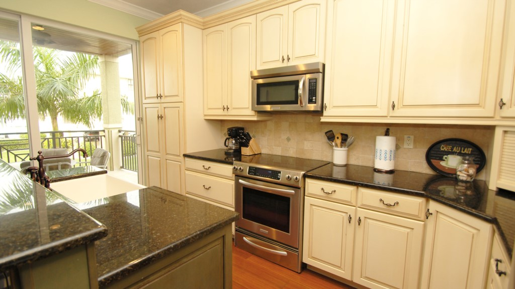Fully stocked kitchen with granite counter tops