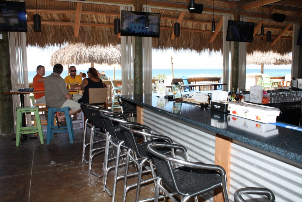 Beach dining at the Tiki Hut featuring live music seven nights a week