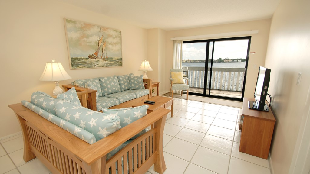 Living room and balcony overlooking the water