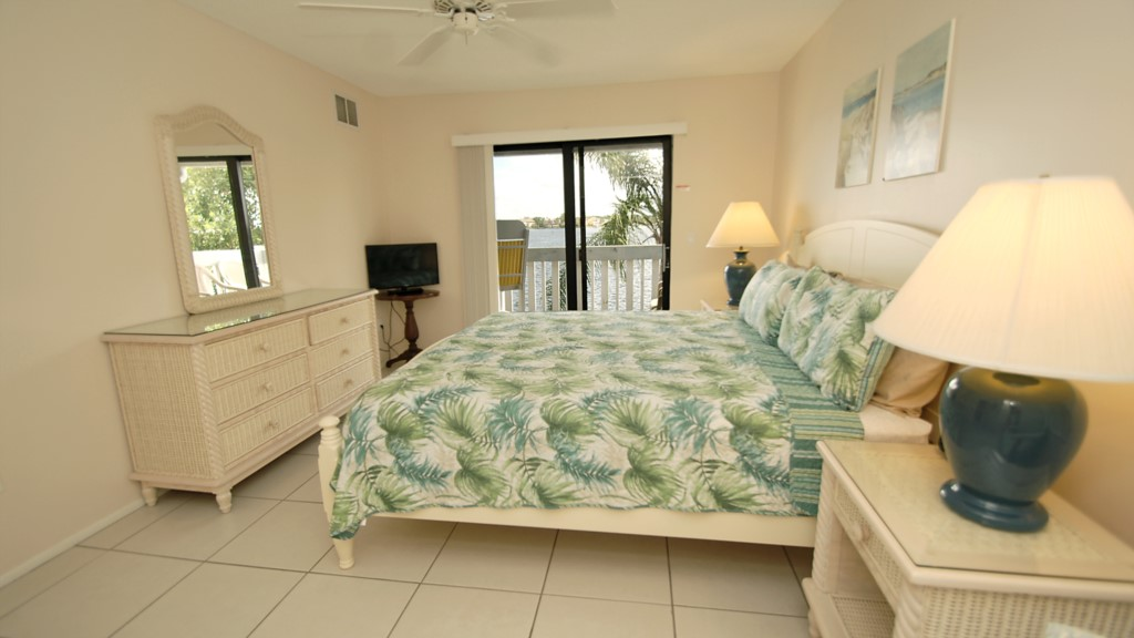 Master bedroom and balcony overlooking the water