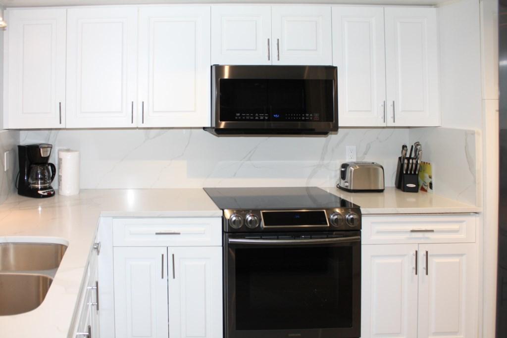 New Designer Kitchen With Quartz Counters-Quartz Backsplash-New Black Graphite Appliances