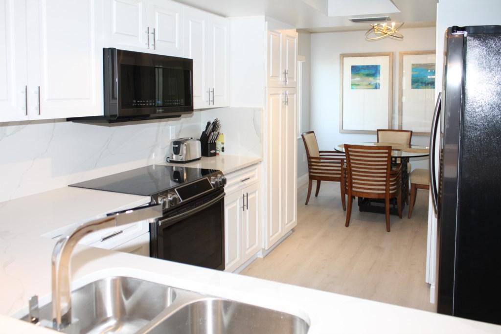 New Designer Kitchen With Quart Counter Tops And Matching Quartz Backsplash