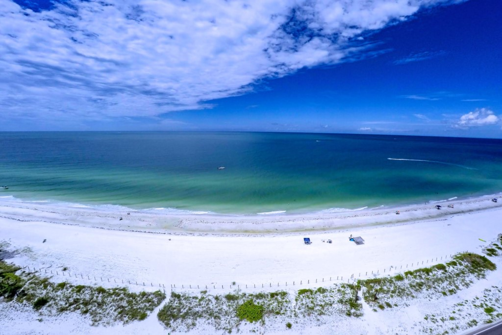 Our drone photo of the beach and Gulf in from of The Beach Sands