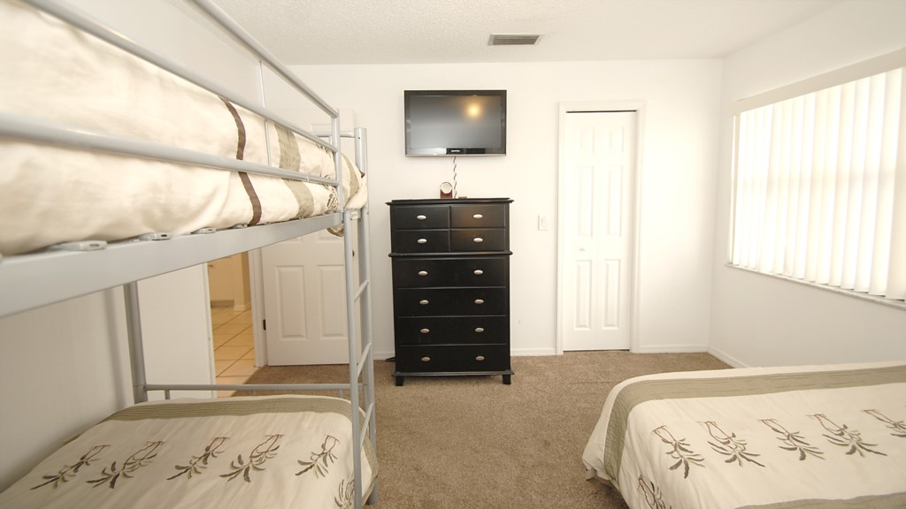 Second bedroom with a mounted flat screen television