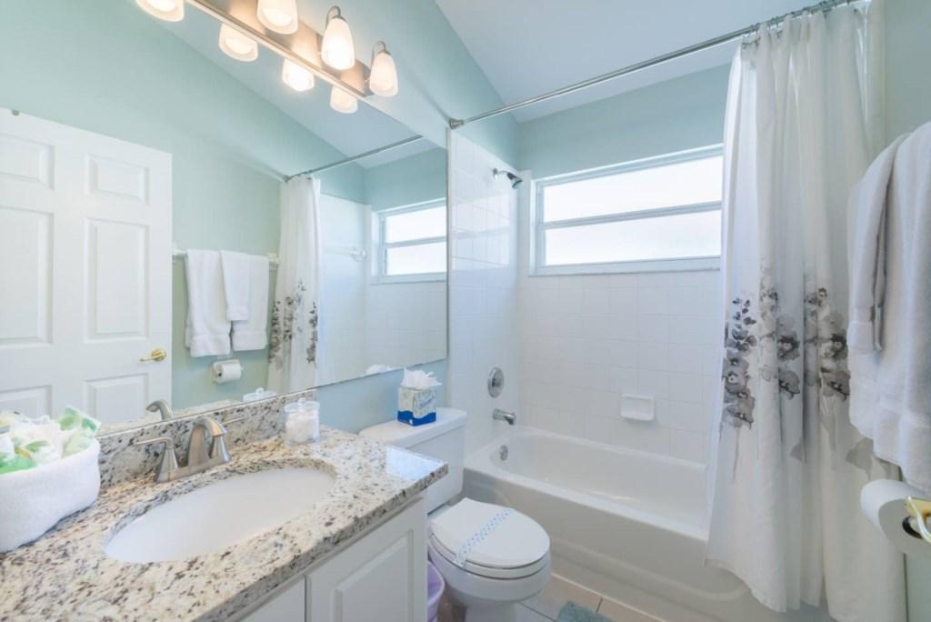 Family bathroom with granite countertops.jpg