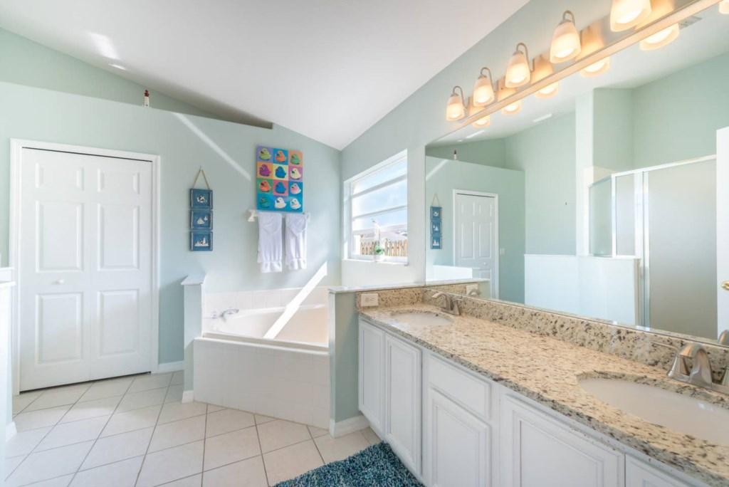 Master bedroom ensuite bathroom with granite countertops.jpg