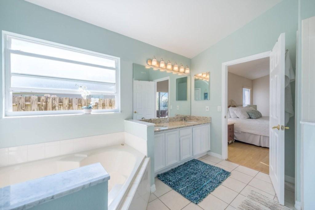 Master bedroom ensuite bathroom with granite countertops2.jpg
