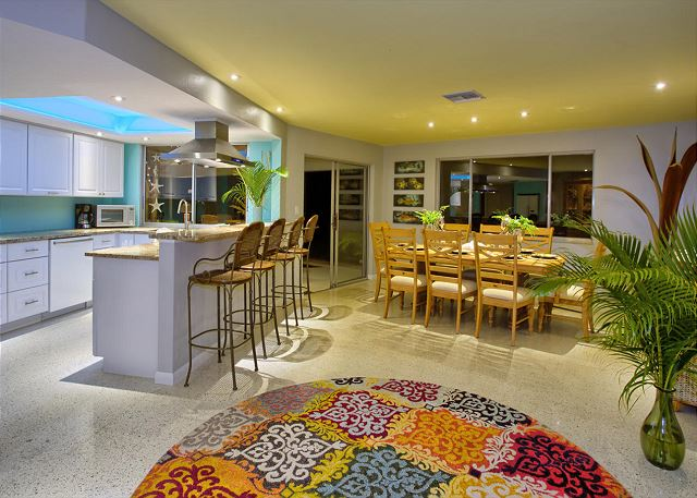 Open kitchen and dining area with pool views