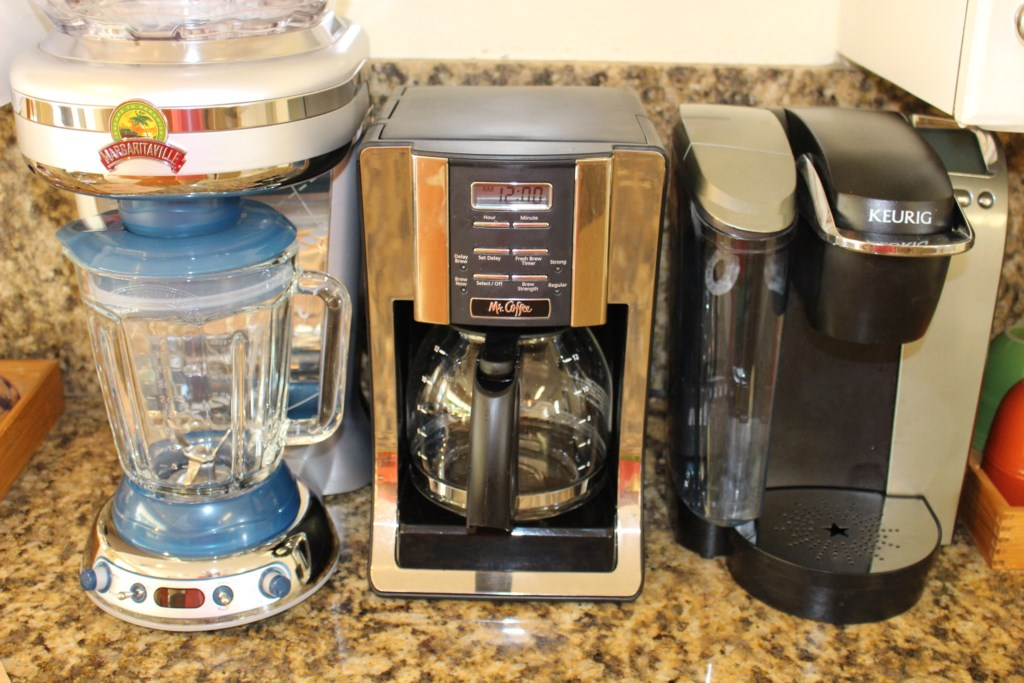BRAND NEW Margaritiville Margarita machine! Also, drip coffee maker and Kuerig