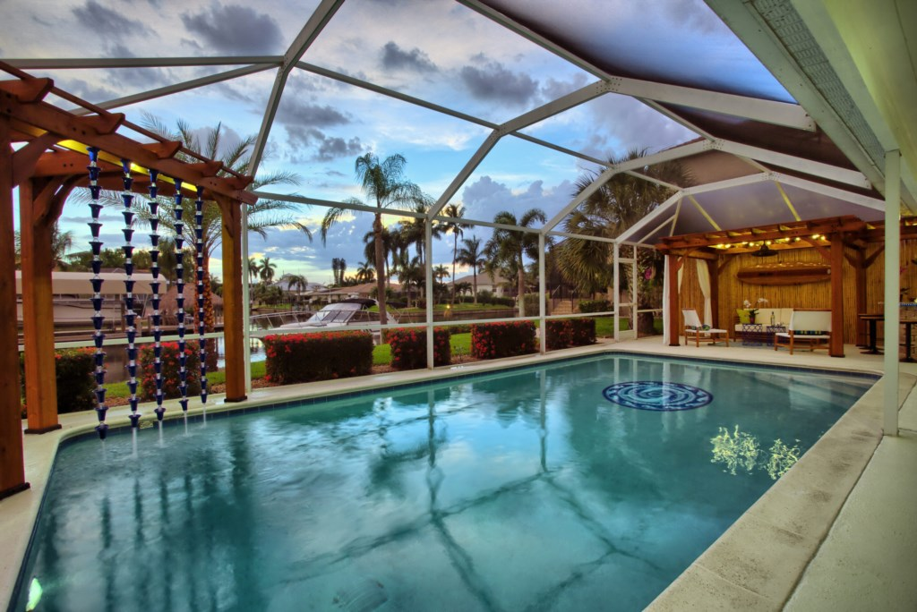 5646RiversideDrCapeCoral-print-031-PoolSunset-4200x2804-300dpi