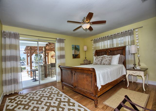 2nd bedroom with water/pool views and queen