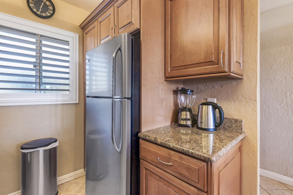Large refrigerator and hidden washer dryer