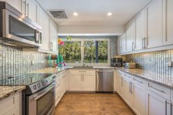 Stainless Steel Appliances and White Cabinetry at The Beach House