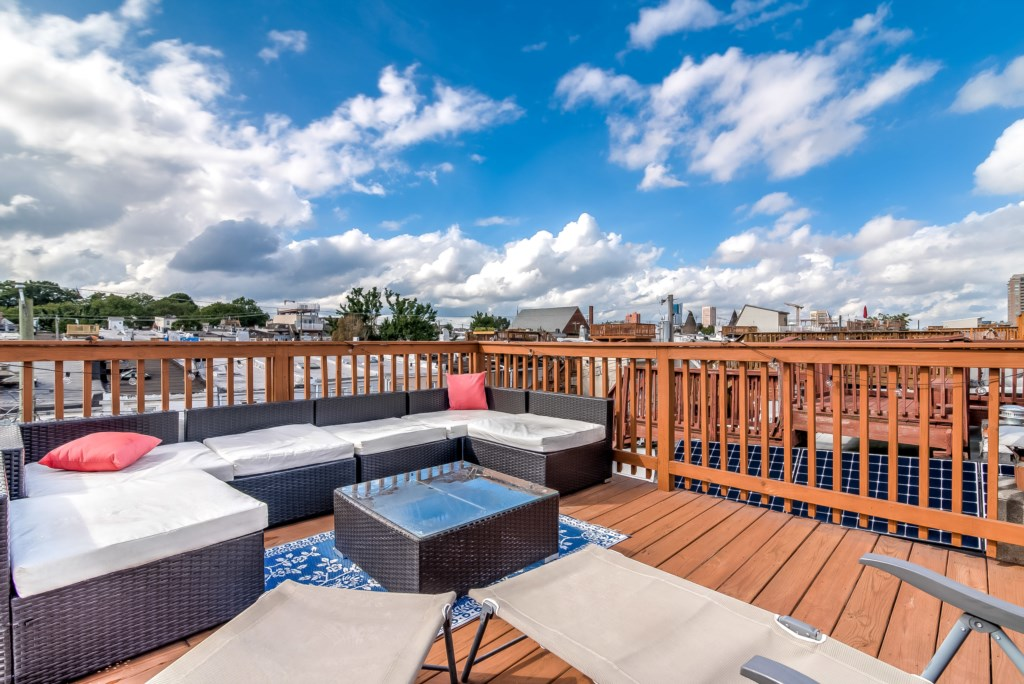 Imagine you and your group enjoying evenings out on this spacious rooftop deck overlooking the city