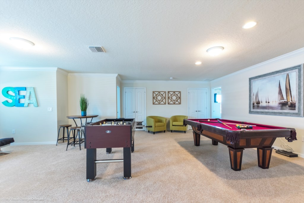 View 3 of fun entertainment room including pool table, foosball, lounge area and flat screen TV