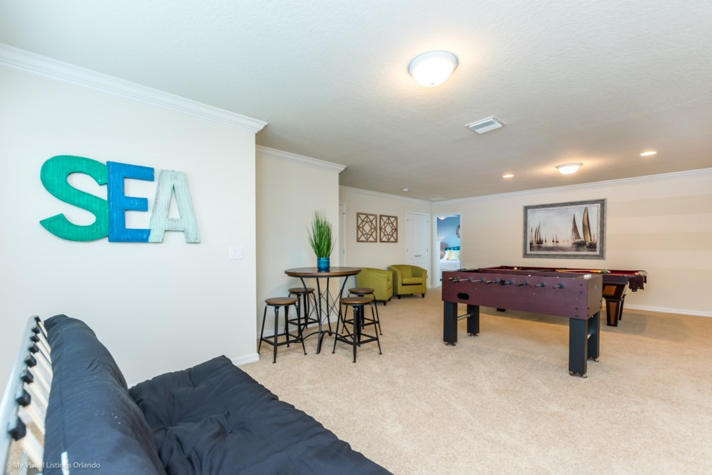 View 7 of fun entertainment room including pool table, foosball, lounge area and flat screen TV