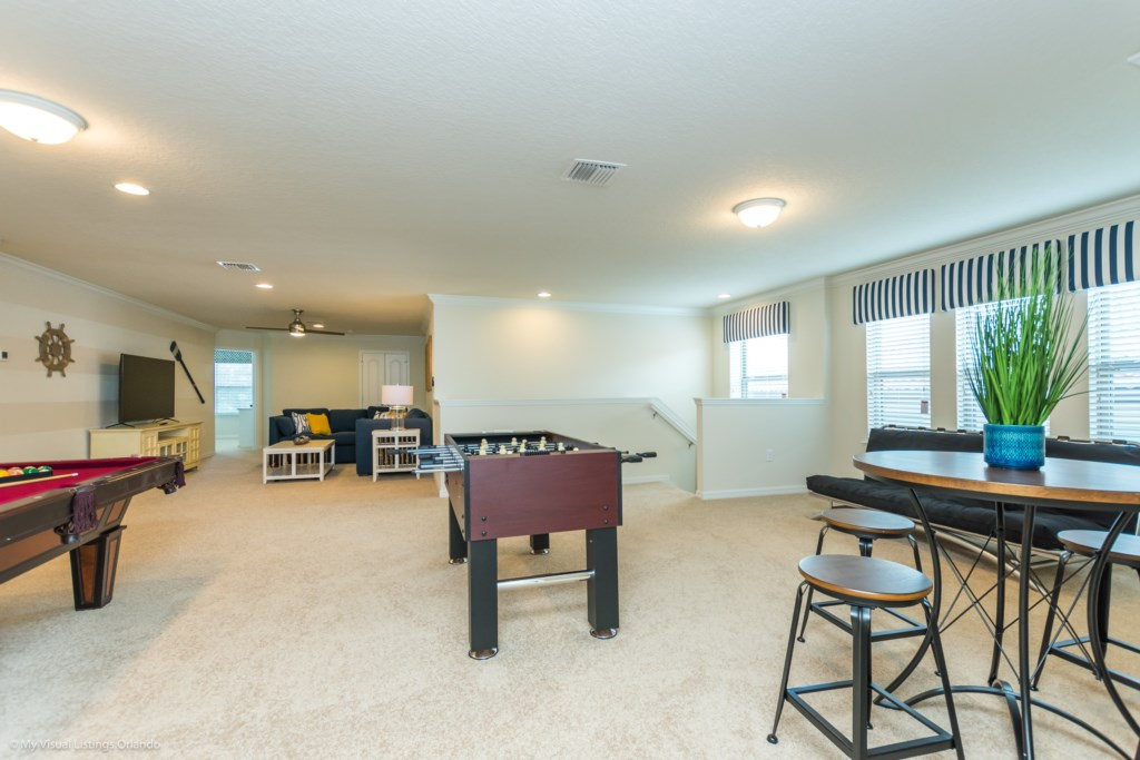 View 5 of fun entertainment room including pool table, foosball, lounge area and flat screen TV