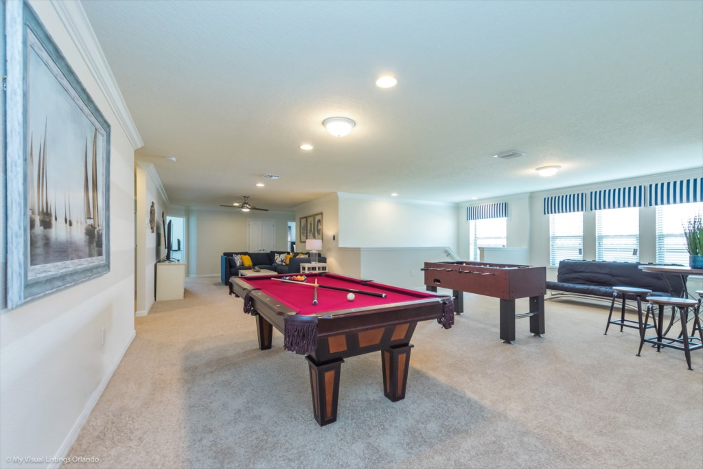 Entertainment room including pool, foosball, lounge area and flat screen TV