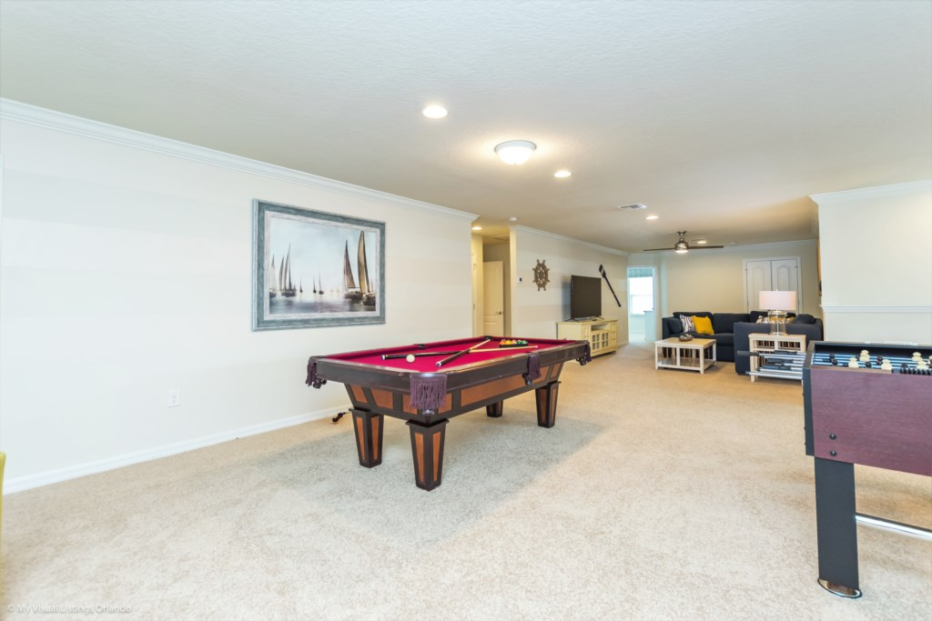 View 4 of fun entertainment room including pool table, foosball, lounge area and flat screen TV