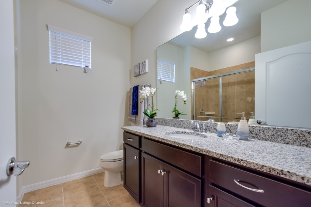 Classic single sink vanity bathroom with shower