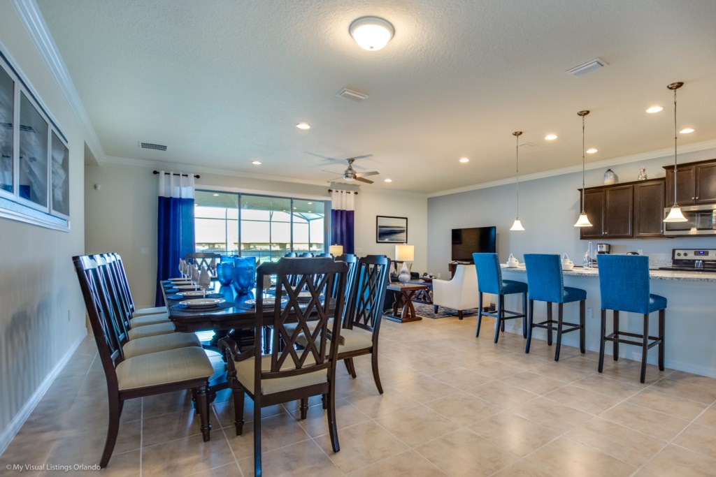 Outstanding view of dining area, living room with flat screen TV, and barstool seating
