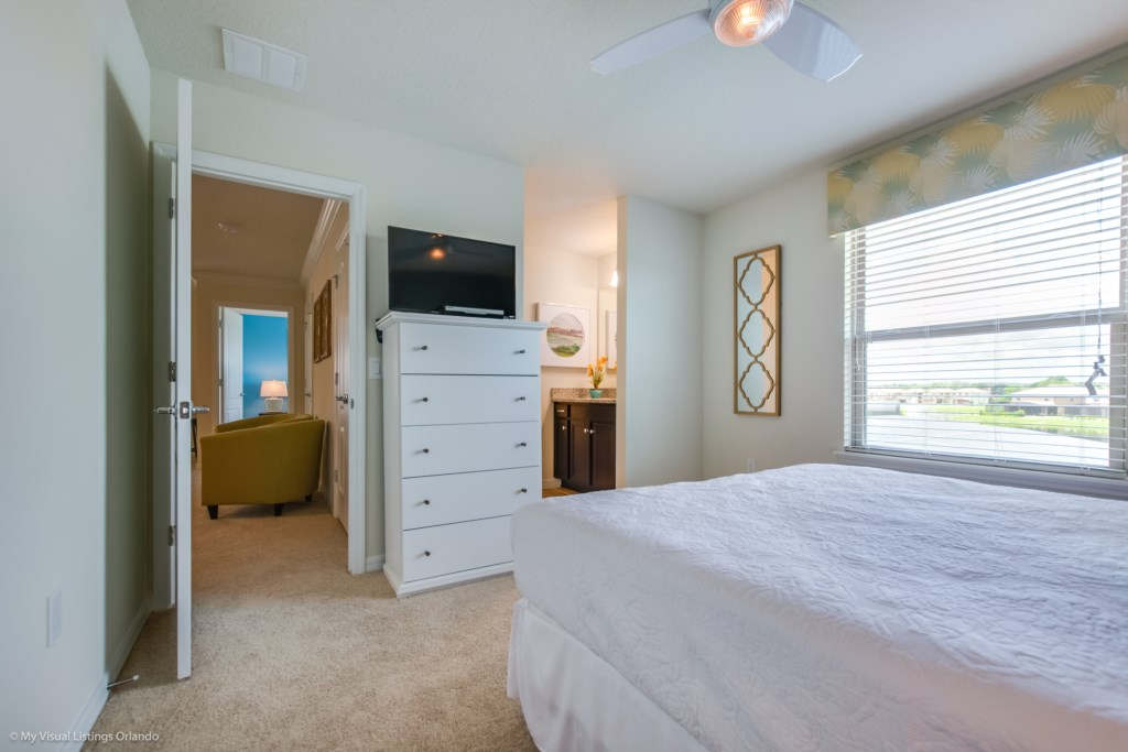 View 4 of lovely queen size bed with closet, flat screen TV, and single sink vanity