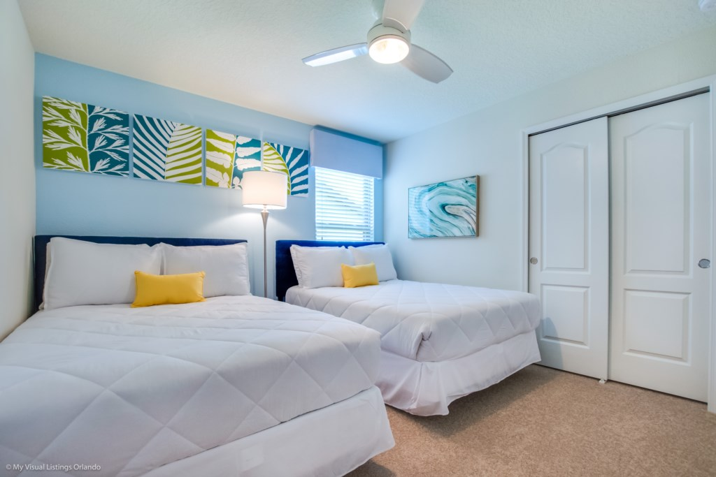 Pleasant 2 queen size beds with closet and flat screen TV