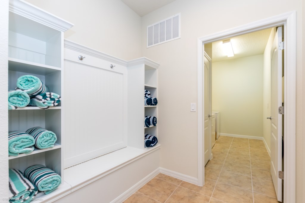 Luxurious laundry room with full size washer and dryer